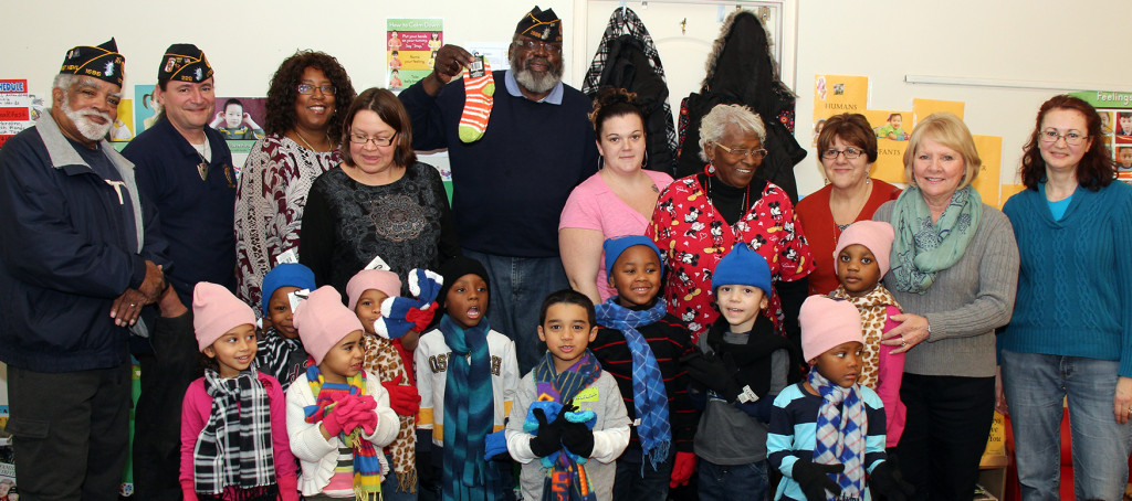 Legion Family members in Utica posed with staff and children in one of the Head Start classes.