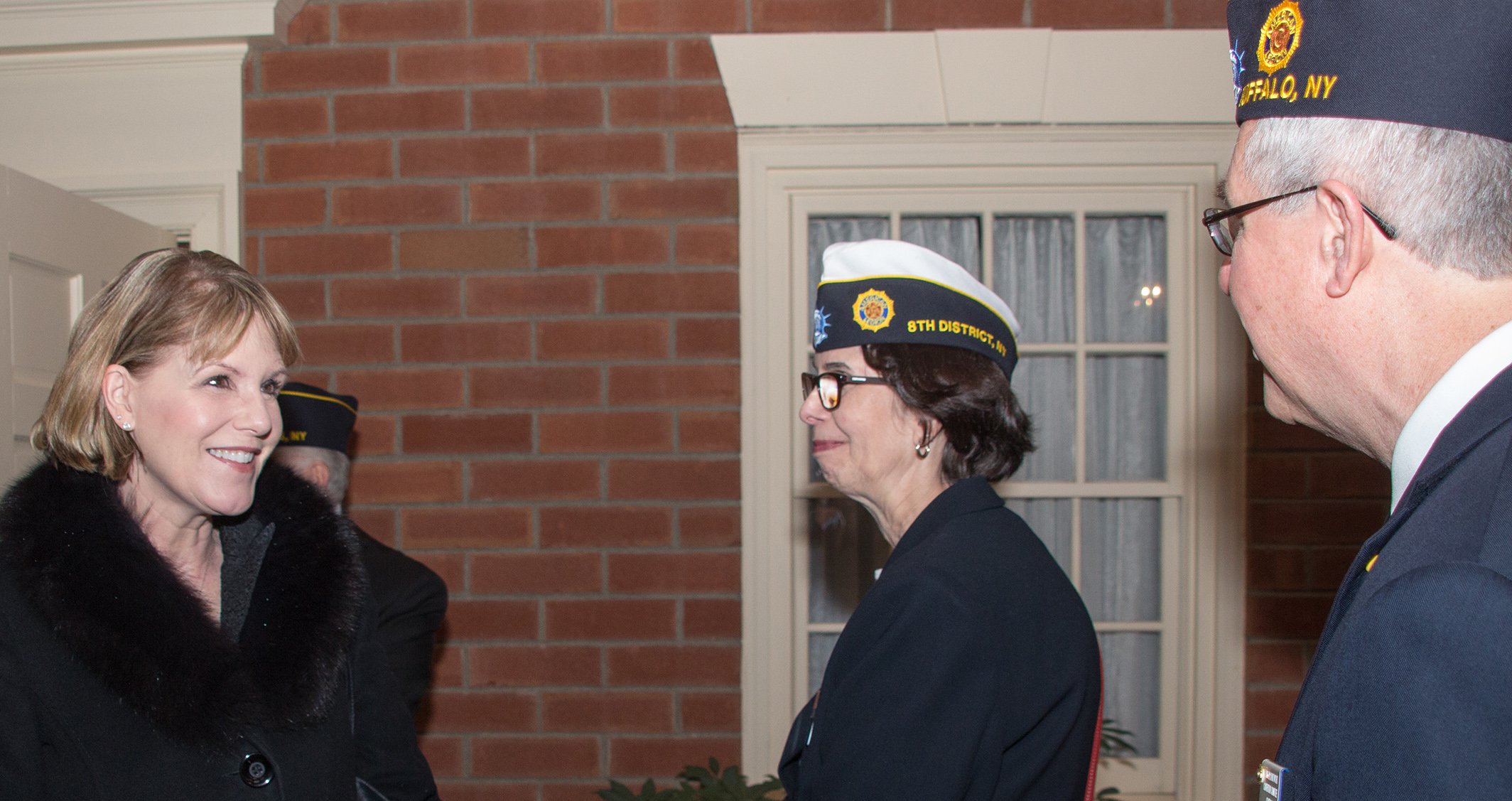 Sen. Catharine Young chats with New York American Legion Press Association Executive Director Lynda Pixley and Erie County Adjutant James Bojanowski on their way into the legislative breakfast.