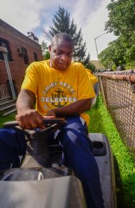 Sailor mows yard at Bronx Post