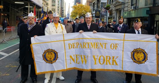 Department Commander Gary Schacher (2nd from left) poses with other New York Legion leaders prior to the start of the parade.