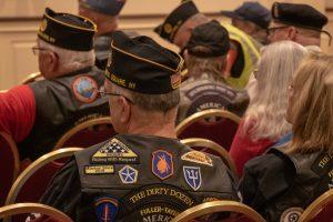 Legion Riders listen to reports.