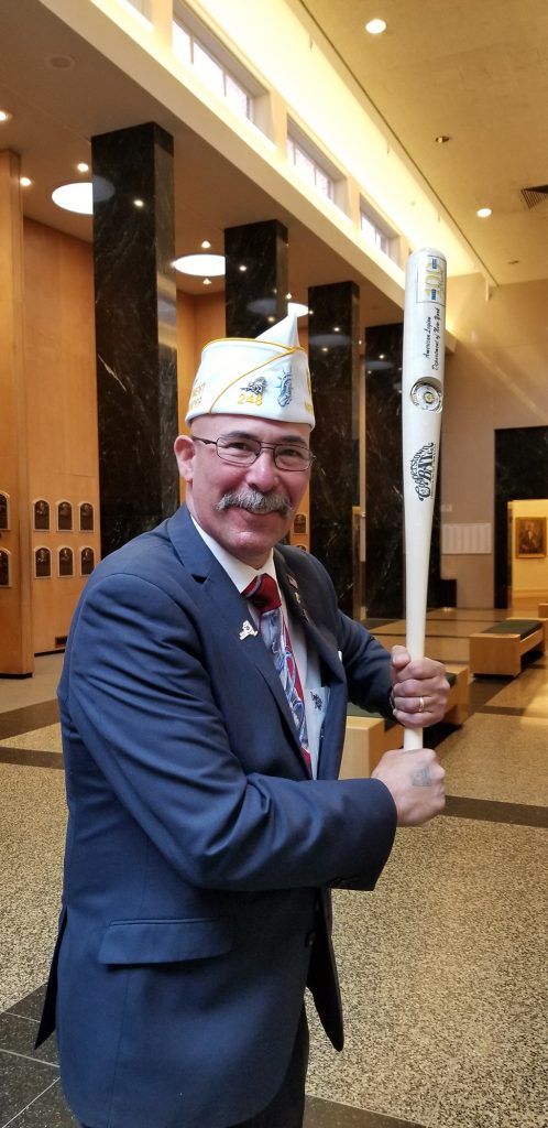 New York American Legion Commander Gary Schacher poses with a Legon Commemorative Bat.
