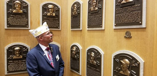 NY Department Commander Gary Schacher admires plaques