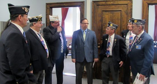 Oneida County Legionnaires visit with Sen. Joe Griffo.
