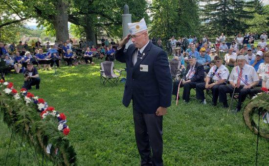 Commander Gary Schacher renders salute at Gettysburg.
